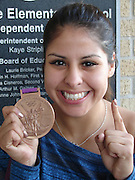 •Park Place Elementary School students met Olympian boxer Marlen Esparza recently when she came to her nieces' campus to surprise them with a visit. Marlen, who took home the bronze medal in the 2012 London game, said that she will begin training for the 2016 Olympics later this year.