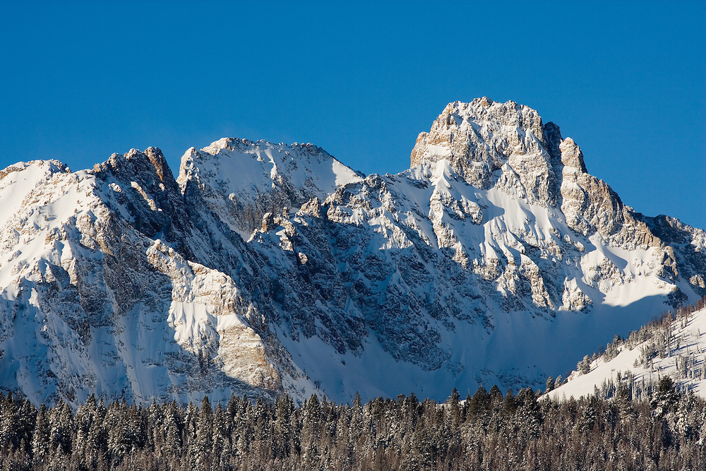 Thompson Peak is the highest peak in the Sawtooth Mountains in Central Idaho at 10751 ft / 3277 meters on a cold winters day.  Licensing and Open Edition Prints.