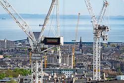 Construction tower cranes at construction site of New St James Centre development in Edinburgh, Scotland, United Kingdom,UK