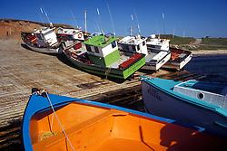 Cap Aux Meules, Magdalen Islands:  Fishing boats await the tide.