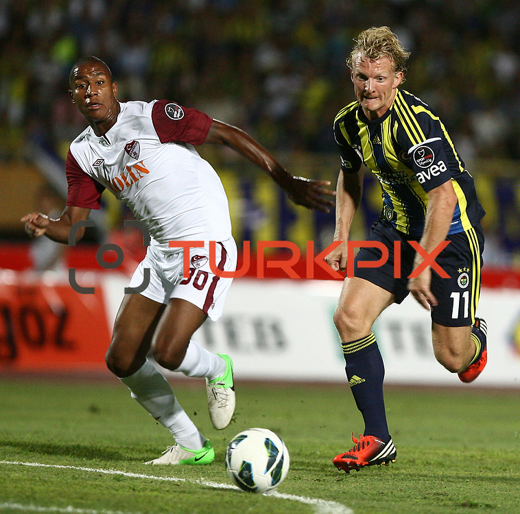 S.B. Elazigspor's Marvin R. Kwasie (L) and Fenerbahce's players Dirk Kuijt (R) and  in action with ball during their Turkish superleague soccer match S.B. Elazigspor between Fenerbahce at the Ataturk stadium in izmir Turkey on Saturday 18 August 2012. Photo by TURKPIX