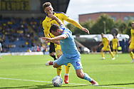 Coventry City midfielder Michael Doyle (8) draws a foul during the EFL Sky Bet League 1 match between Oxford United and Coventry City at the Kassam Stadium, Oxford, England on 9 September 2018.