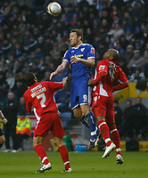 Photo: Steve Bond/Richard Lane Photography. Leicester City v Leyton Orient. Coca Cola League One. 10/01/2009. Steve Howard (C) wins the ball in the air, with Alton Thelwell (R) and JJ Melligan (L) in attendance