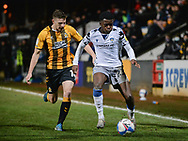 Colchester United's Kwame Poku (23) battles for possession with Paul Mullin (10) of Cambridge United during the EFL Sky Bet League 2 match between Cambridge United and Colchester United at the Cambs Glass Stadium, Cambridge, England on 15 December 2020.