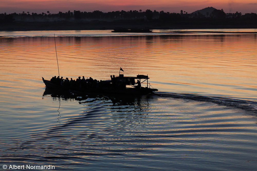 Crowded commuter boat leaving after sunset, Chindwin River