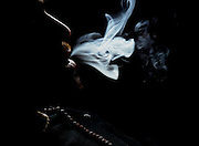 dark and ominous Portrait of a man smoking. Model release available