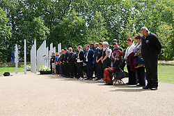 © London News Pictures. 07/07/15. London, UK. Workers preparing for the Memorial Service in Hyde Park later this afternoon hold a minute's silence to mark the 10 year anniversary of the 7/7 London bombings, Central London. Photo credit: Laura Lean/LNP