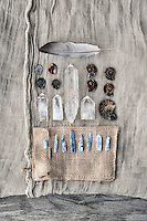 """A simple dove feather highlighting a collection of ammonite fossils, crystal, and Kyanite stone.<br /> <br /> ::::::::::::::::::::::::::::::::::::::::<br /> <br /> """"I am generating higher vibrational energies of choice and non-attachment.""""<br /> ~Elena Ray <br /> <br /> 