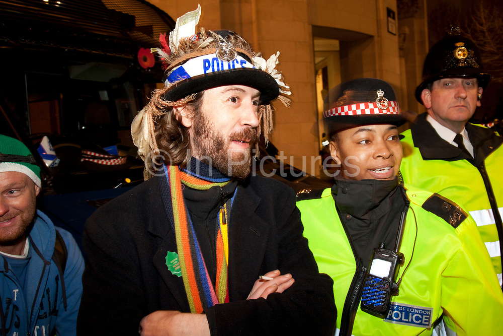Police and protesters having a little good humoured fun as eviction of the Occupy London OLSX camp takes place. The anti-capitalist demonstration that saw protesters camp outside St Paul's Cathedral in London was brought to an end by bailiffs and police. Protesters staging Occupy London were refused permission by the Court of Appeal last week to challenge orders evicting them from the cathedral steps, where they had been living in tents since October 15 last year. The City of London Corporation called on protesters to remove their tents voluntarily, but around 50 or 60 refused to budge. Some protesters created makeshift barriers out of wooden shelving units as police moved in to help bailiffs clear the camp. Police said 20 people had been arrested but the operation was largely peaceful.