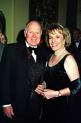 MR DESMOND WILCOX and his wife TV presenter ESTHER RANTZEN, at a ball in London on 5th February 2000.OAW 12