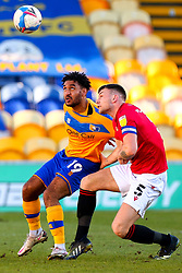 Jamie Reid of Mansfield Town and Sam Lavelle of Morecambe tussle for possession - Mandatory by-line: Ryan Crockett/JMP - 27/02/2021 - FOOTBALL - One Call Stadium - Mansfield, England - Mansfield Town v Morecambe - Sky Bet League Two