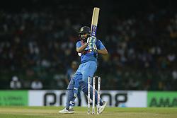 March 12, 2018 - Colombo, Sri Lanka - Indian cricket captain Rohit Sharma plays a shot during the 4th Twenty-20 cricket match of NIDAHAS Trophy between Sri Lanka  and India at R Premadasa cricket ground, Colombo, Sri Lanka on Monday 12 March 2018. (Credit Image: © Tharaka Basnayaka/NurPhoto via ZUMA Press)