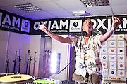 DJ Fatboy Slim plays Oxjam in the Tooting Oxfam charity shop. London.