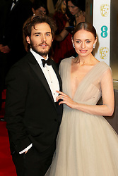 © London News Pictures. Sam Claflin, Laura Haddock, EE British Academy Film Awards (BAFTAs), Royal Opera House Covent Garden, London UK, 08 February 2015, Photo by Richard Goldschmidt /LNP