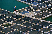 Overview of a worker in the salt pans along the northern coastline around Xwejni.