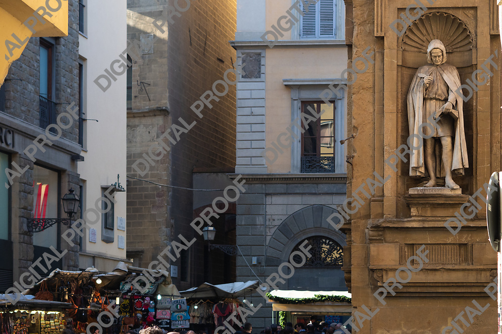 Firenze, Tuscany Italy - December 30, 2018 Detail of Giovanni Villani statue in Piazza de la Signoria with florence streets at the background