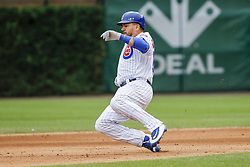August 4, 2017 - Chicago, IL, USA - The Chicago Cubs' Kyle Schwarber slides safely into second base with a double in the seventh inning against the Washington Nationals at Wrigley Field on Friday, Aug. 4, 2017. The Nationals won, 4-2. (Credit Image: © Jose M. Osorio/TNS via ZUMA Wire)