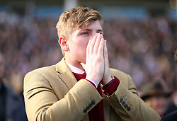 A racegoer reacts during the Sun Bets Slayers Hurdle Race during St Patrick's Thursday of the 2018 Cheltenham Festival at Cheltenham Racecourse.