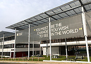 University of Suffolk buildings, Ipswich, England, UK with Mahatma Gandhi quotation about change in the world
