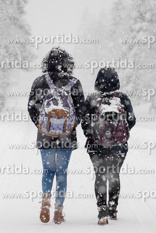 THEMENBILD - Schülerinnen auf dem Heimweg aufgenommen am Freitag, 15. November 2019, in Huben in Osttirol. Die extremen Schneefälle der vergangenen Tage sorgen in Teilen Österreichs für massive Gefahren und Behinderungen // Pupils on the way home pictured on Friday, November 15, 2019, in Huben in East Tyrol. The extreme snowfalls of the past few days cause massive dangers and disabilities in parts of Austria. EXPA Pictures © 2019, PhotoCredit: EXPA/ Johann Groder