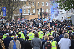 © Licensed to London News Pictures. 20/04/2021. London, UK. Thousands of fans gather outside Stamford Bridge in West London ahead of the Premiere League game between Chelsea and Brighton, to demonstrate against plans for a European Super League. There has been widespread hostility towards proposals for a new elite league of European football clubs, which opponents say will kill competition and damage the sport. Photo credit: Ben Cawthra/LNP