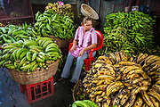 08 JANUARY 2007 - MANAGUA, NICARAGUA:  A banana vendor with her wares in Mercado Oriental, the main market that serves Managua, Nicaragua. The market encompasses dozens of square blocks and is the largest market in Central America.  Photo by Jack Kurtz
