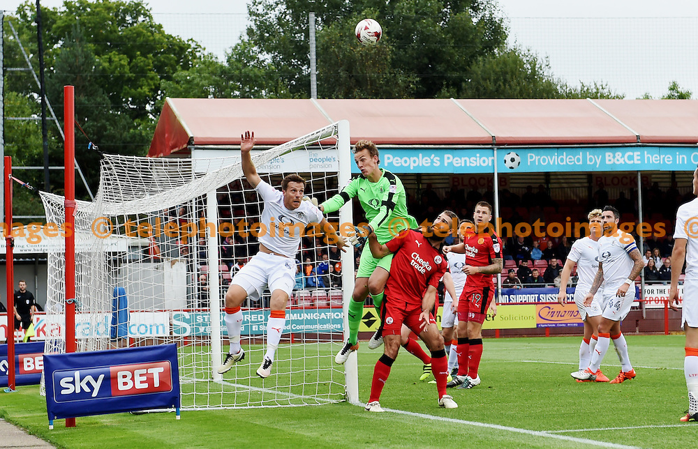 Johnny Mullins of Luton and goalkeeper Christian Walton scramble the ball clear under pressure from Joe McNerney of Crawley during the Sky Bet League 2 match between Crawley Town and Luton Town at the Checkatrade Stadium in Crawley. September 17, 2016.<br /> Simon  Dack / Telephoto Images<br /> +44 7967 642437
