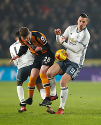 Manchester United's Zlatan Ibrahimovic (right) and Hull City's Josh Tymon in action during the EFL Cup Semi Final, Second Leg match at the KCOM Stadium, Hull.