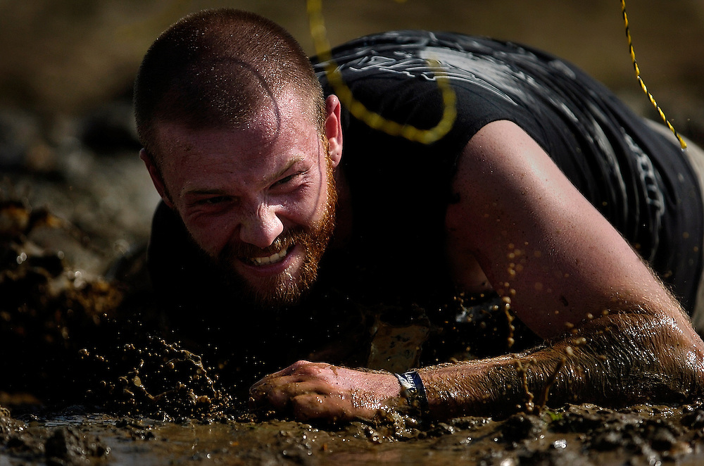 A participant crawls his way through the mud-drenched course during the Rock Solid Mud Run held at Old Bridge Township Raceway Park in Englishtown on August 6. Rock Solid Mud Run is an all-terrain adventure that involves mastering obstacles along either a five or ten-mile course. Participants ran, swam, crawled, climbed, jumped while covering four motocross tracks, hundreds of acres of woods, three lakes, and two asphalt racetracks.