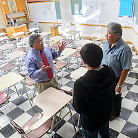 081414       Cable Hoover<br /> <br /> Diné language and government teacher William Nakai, left, greets Larry Johnson and incoming sophomore Aeron Johnson during the Saint Michael Indian School back to school event Thursday.
