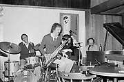 """9702-57-06. """"Ed Beach Quartet about March 1983. Village Jazz. Mel Brown - drums; Lee Wuthernow- reeds; Tom Wakeling- bass."""" (Village Jazz was located in Lake Oswego)"""