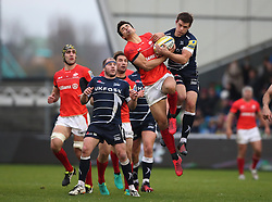 Saracens's Alex Lozowski catches high ball with Sale Sharks' AJ MacGinty during the Aviva Premiership match at The AJ Bell Stadium, Sale.