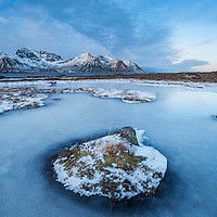 Frozen pond in winter, Lofoten Islands, Norway
