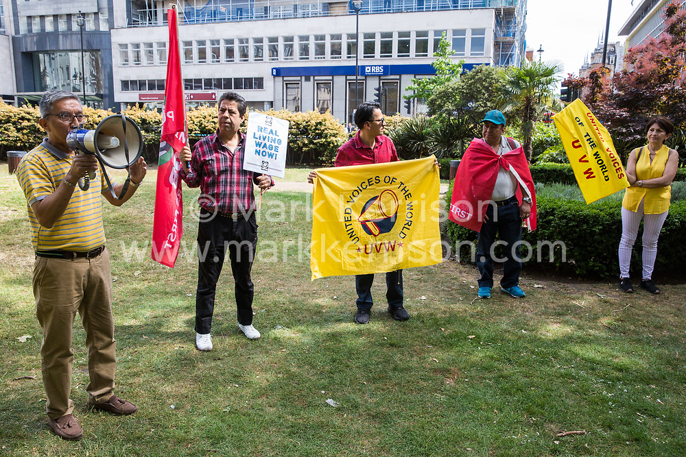 London, UK. 1 June, 2019. A member of the Independent Workers of Great Britain (IWGB) trade union addresses members of the United Voices of the World (UVW) and IWGB grassroots trade unions before a protest inside the DoubleTree Hilton Hotel in solidarity with Dalia Quinonez Guerrero, a former cleaner from whom wages were withheld. The protest was previously arranged to have taken place outside Chanel but arrangements were changed after the global fashion chain agreed to pay its cleaners the London Living Wage at its stores.