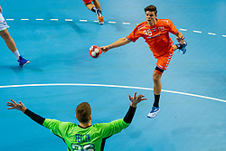 The Dutch handball player Rutger ten Velde in action against Klemen Ferlin from Slovenia during the European Championship qualifying match on January 6, 2020 in Topsportcentrum Almere