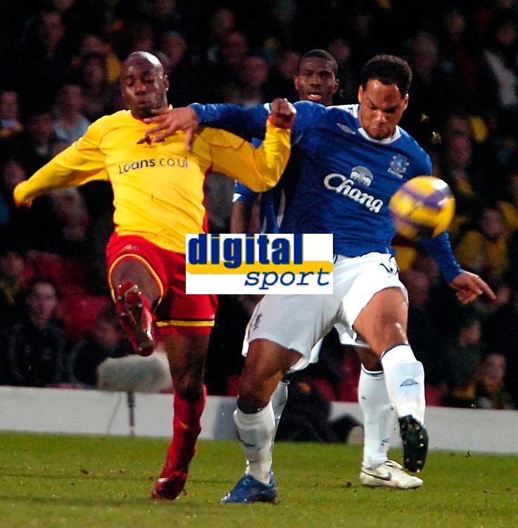Photo: Ed Godden/Sportsbeat Images.<br /> Watford v Everton. The Barclays Premiership. 24/02/2007.<br /> Watford's Steve Kabba (L), is tackled by Joleon Lescott.