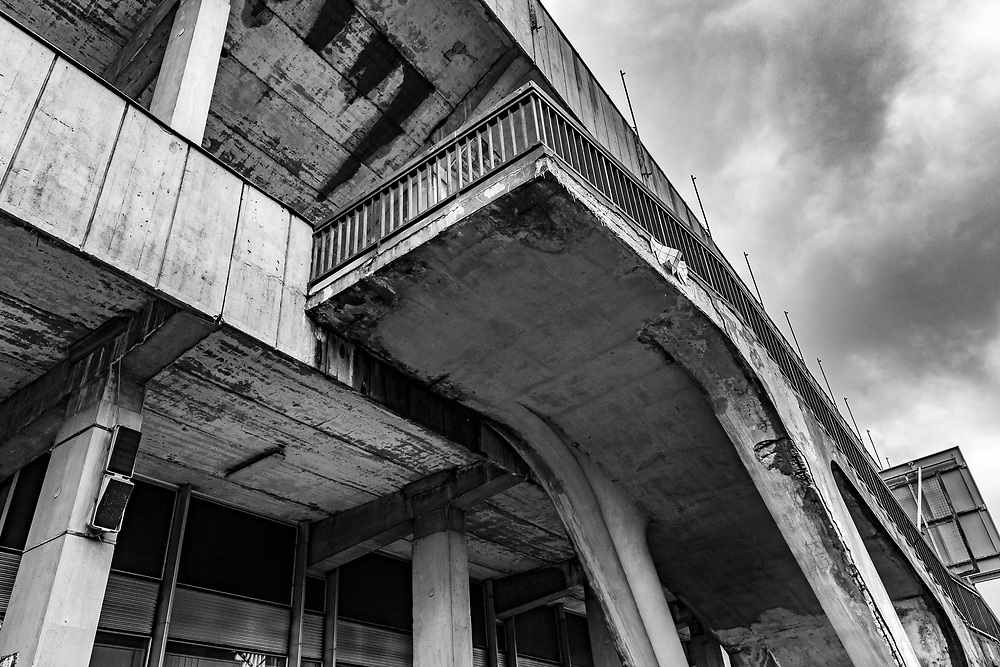 """Prague, Czech Republic. December 2018.<br /> The abandoned Strahov Stadium lies in a state of decay. Construction began in 1926 based on the plans of architect Alois Dryák but its wooden construction was quickly replaced by concrete grandstands in 1932. <br /> Under the communist regime it was used to display massive synchronised gymnastic events known as """"Spartakiads"""". <br /> The Stadium is the biggest of its kind - covering an area of eight football pitches."""