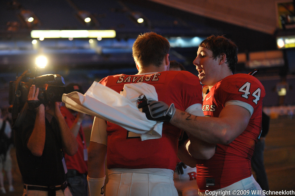 Dec 20, 2009; St. Petersburg, Fla., USA; Rutgers quarterback Tom Savage (7) and linebacker Ryan D'Imperio (44) congradulate eachother following Rutgers' 45-24 victory over Central Florida in the St. Petersburg Bowl at Tropicana Field.
