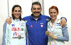 Physiotherapist Khalid Nasif, Sonja Roman (R) with bronze medal at 1500 m run   and Marija Sestak (L) after she won second place at triple jump at the 3rd day of  European Athletics Indoor Championships Torino 2009 (6th - 8th March), at Oval Lingotto Stadium,  Torino, Italy, on March 8, 2009. (Photo by Vid Ponikvar / Sportida)