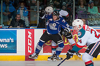 KELOWNA, CANADA - DECEMBER 30: Blake Bargar #16 of the Victoria Royals checks Kyle Topping #24 of the Kelowna Rockets into the boards during first period on December 30, 2016 at Prospera Place in Kelowna, British Columbia, Canada.  (Photo by Marissa Baecker/Shoot the Breeze)  *** Local Caption ***