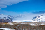 Blue sky over glacial tongue of Svinafellsjokull glacier an outlet glacier of Vatnajokull, the largest ice cap in Europe, South Iceland
