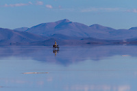 Biking Salar de Coipasa <br /> <br /> Lago Coipasa or Salar de Coipasa is a lake in Atahuallpa Province, Oruro Department, Bolivia. At an elevation of 3657 m, its surface area is 806 km². It's on the western part of Altiplano, 20 km north of Salar de Uyuni and south of the main road linking Oruro and Huara (Chile).<br /> <br /> Coipasa Lake is a tectonic saline lake with a depth of 3.5 metres that is surrounded by the Coipasa salt flats (Salar de Coipasa)