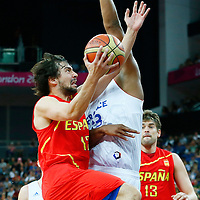 08 August 2012: Spain Sergio Llull goes for the layup over France Boris Diaw during 66-59 Team Spain victory over Team France, during the men's basketball quarter-finals, at the 02 Arena, in London, Great Britain.