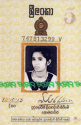 Photograph of the identity card of Poline Carmel Moses, sister of Judeson Britto Moses, is seen in Batticaloa, Sri Lanka, Jan. 30, 2005. Moses' sister died along with the rest of his immediate family in the tsunami that hit his beach village.