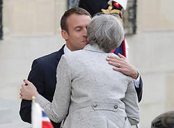 French President Emmanuel Macron greets Prime Minister Theresa May at the Elysee Palace during her visit to Paris, France.
