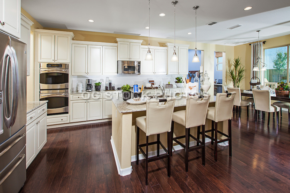 Cozy Kitchen with Brown Tone Hardwood Floors and White Cabinets