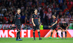 Arsenal's Aaron Ramsey and Arsenal's Granit Xhaka shows their dejecton after their side concede during the UEFA Europa League, Semi Final, Second Leg at Wanda Metropolitano, Madrid.