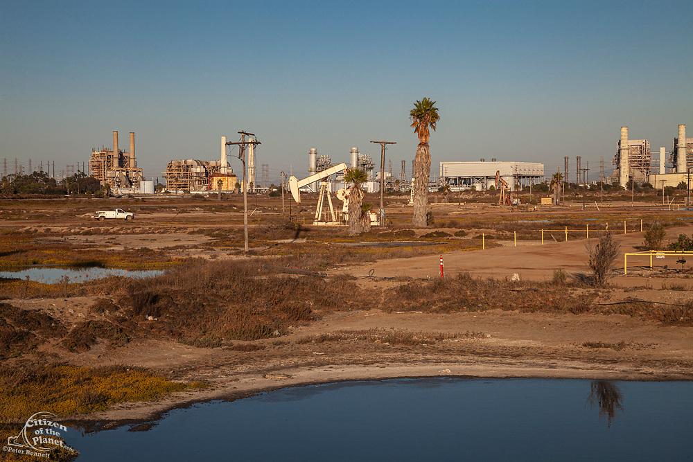 Oil pumpjacks in the Los Cerritos Wetlands, Long Beach, california, USA