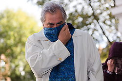 © Licensed to London News Pictures. 21/10/2014. London, UK. Mafia boss, Domenico Rancadore arrives at Westminster Magistrates Court in London on 21st October 2014 for an extradition hearing, which is a second attempt to return him to Italy to serve a jail term for being a member of the Cosa Nostra. The court is expected to hear from an expert for the defence on prison conditions in Italy today. Rancadore spent almost two decades living incognito in Uxbridge, west London until arrested last August. Photo credit : Vickie Flores/LNP