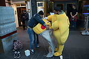 Promotional Pokemon Pikatchu removes his head at the end of a days work in London, England, United Kingdom. Pikachu are a species of Pokemon, fictional creatures that appear in an assortment of video games, animated television shows and movies, trading card games, and comic books licensed by The Pokémon Company, a Japanese corporation.